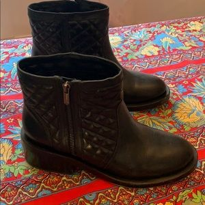 Black ankle heavy moto boots